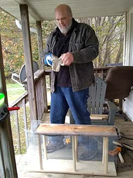The author building a drawbridge in the porch