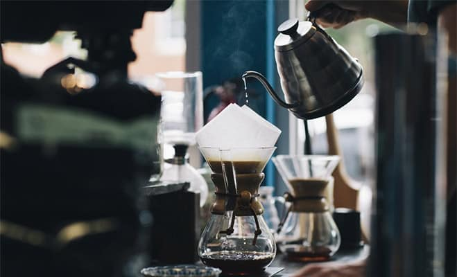 Pouring hot water to coffee filter in a chemex decanter