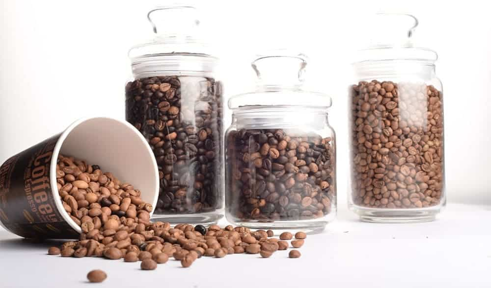 Coffee Beans in a cup and in clear containers