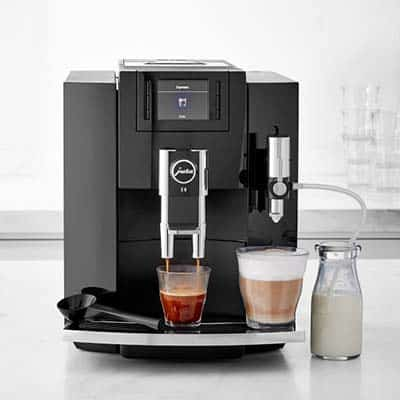 Jura Impressa E8 Espresso Machine extracting a shot of espresso and frothing milk